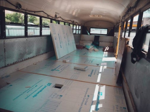 Laying floors in our skoolie was the first big project we go to do. | sincewewokeup.com | Since We Woke Up