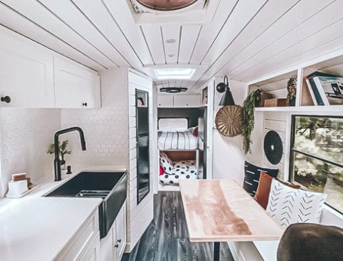 Today we're featuring Our Van Quest - a clean and bright white skoolie conversion that has everything a family of four needs travel in style! | Since We Woke Up | www.sincewewokeup.com