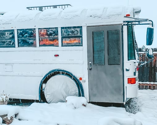 Living in a skoolie in the winter isn't just doable, it can be downright fun and cozy! Click here to learn our best winter RV tips! | www.sincewewokeup.com | Since We Woke Up